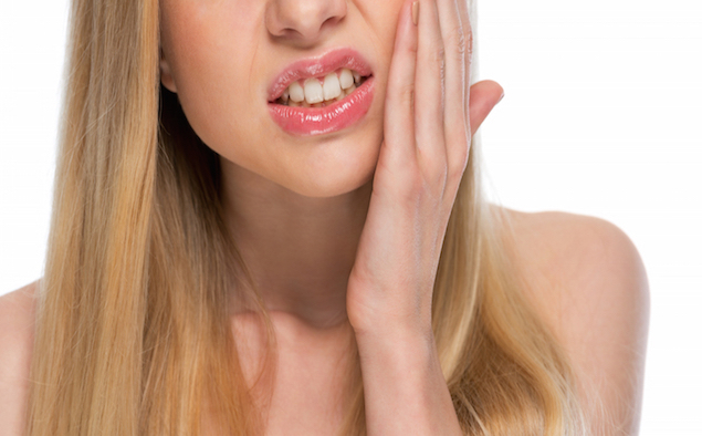 Closeup on teenager with toothache