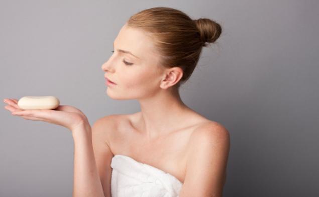 woman using a soap bar